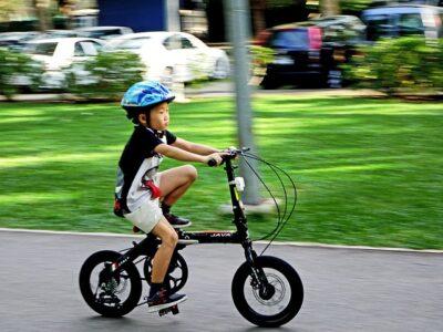 A kid is riding bike