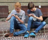 Boys playing mobile games
