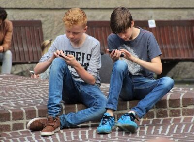 Boys playing mobile games