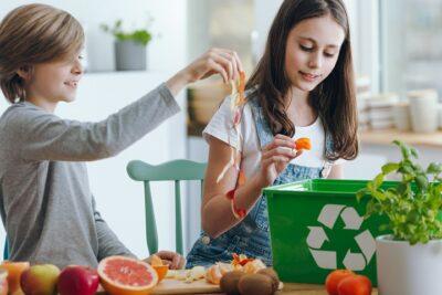 Girl throwing fruits waste in wastebin