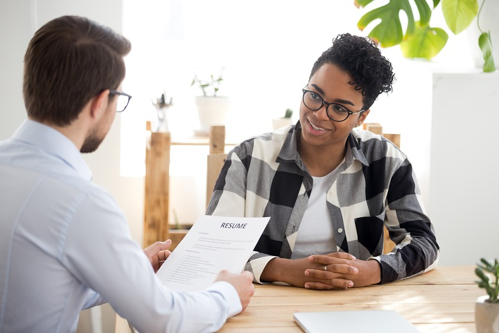 Male employer interview smiling black female applicant